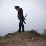 Kurdish woman on the frontline in Syria. Image by  AP.