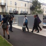 Press pack chasing heroes & villains outside the Coroner's Court.