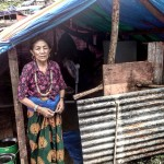 Woman displaced from Doti, living in camp in Barabhise. She is a single woman, her daughters came with her. She has sold her jewelry to get food for the monsoon as the earthquake landslides destroyed their land.